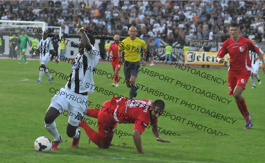 Fudbal Super liga season 2013-2014<br /> Radnicki (Nis) v Partizan<br /> Duel Nikole Fafane Beko Ismaila (Partizan) i Milosa Zivkovica (Radnicki)<br /> Nis, 17.08.2013.<br /> foto: Sasa Djordjevic/Starsportphoto &Acirc;&copy;