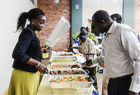 Mary Kuanen helps put out food during a church event at the Hip Hop Church of Denver in Denver, Colorado, Saturday, October 22, 2016. Kuanen a refugee from Sudan moved to Denver 11 years ago with her husband and children. Five years ago her husband was murdered in a mistaken identity gang shooting. <br /> <br /> Photo by Matt Nager