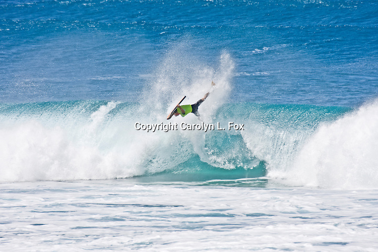A man wipes out as he tries to surf.