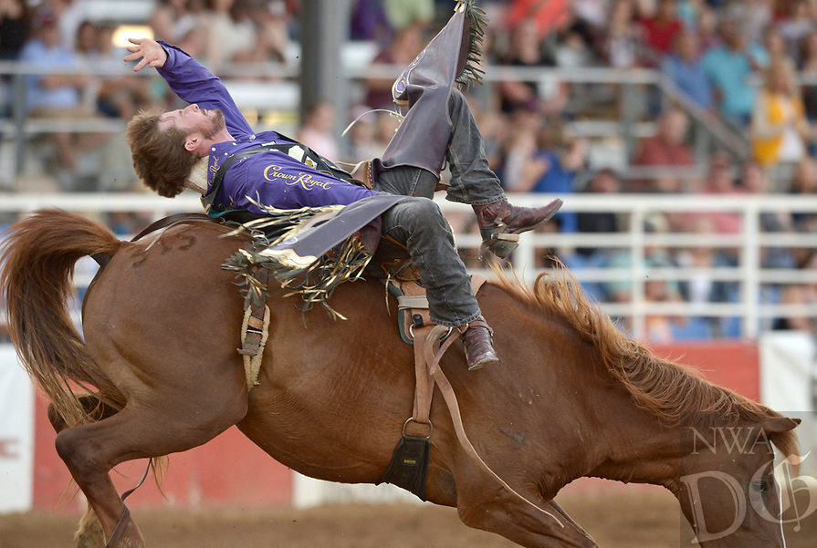 NWA Democrat-Gazette/BEN GOFF @NWABENGOFF<br /> Tilden Hooper of Carthage, Texas competes in the bareback riding event Friday, June 23, 2017, during the third night of the 73rd annual Rodeo of the Ozarks at Parsons Stadium in Springdale. Hooper received a score of 82.5 for the ride.