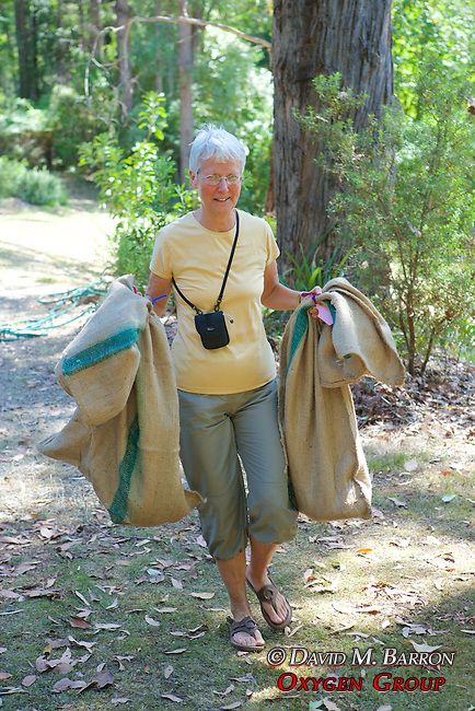 Amy Kvalseth Carrying Possums In Burlap Bags