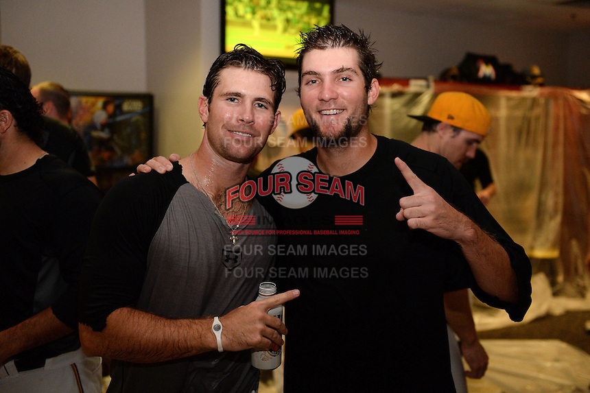 Jacksonville Suns pitchers Reid Redman and Trevor Williams celebrate in the locker room after game three of the Southern League Championship Series against the Chattanooga Lookouts on September 12, 2014 at Bragan Field in Jacksonville, Florida.  Jacksonville defeated Chattanooga 6-1 to sweep three games to none.  (Mike Janes/Four Seam Images)