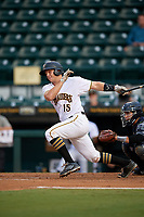 Bradenton Marauders catcher John Bormann (15) follows through on a swing during the second game of a doubleheader against the Tampa Yankees on June 14, 2017 at LECOM Park in Bradenton, Florida.  Tampa defeated Bradenton 5-1.  (Mike Janes/Four Seam Images)