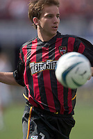 The MetroStars' Mike Magee chases a ball towards the corner.  D. C. United was defeated by the NY/NJ MetroStars 3 to 2 during the MetroStars home opener at Giant's Stadium, East Rutherford, NJ, on April 17, 2004.