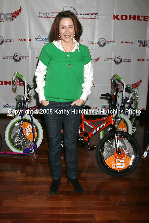 Patricia Heaton with bikes to be given away  at the 14th Annual Christmas in the City Giveaway at the Galen Center at USC in Los Angeles, CA on December 21, 2008.©2008 Kathy Hutchins / Hutchins Photo..                .