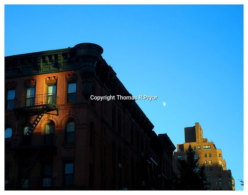 NEW YORK, NY - NOVEMBER 5: Full moon over 83rd street in Yorkville, New York on November 5, 2011. Photo Credit: Thomas R Pryor