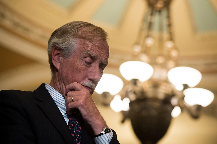 UNITED STATES – June 26: Sen. Angus King, I-Maine, listens as his Democratic colleagues speak to the press after the Senate Democrats' policy lunch in the Capitol on Tuesday, June 26, 2018.  (Photo By Sarah Silbiger/CQ Roll Call)