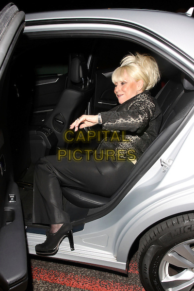 BARBARA WINDSOR .The Sun's new magazine 'Buzz' launch at Il Bottacio, London, England..September 15th, 2010.full length babs brown suit black trousers beige top side leopard print blazer jacket  car sitting funny .CAP/AH.©Adam Houghton/Capital Pictures.