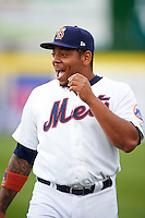 Binghamton Mets first baseman Dominic Smith (22) jokes with a teammate before a game against the Trenton Thunder on May 29, 2016 at NYSEG Stadium in Binghamton, New York.  Trenton defeated Binghamton 2-0.  (Mike Janes/Four Seam Images)