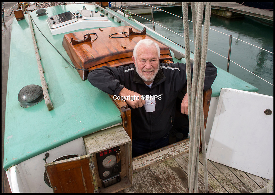 BNPS.co.uk (01202 558833)Pic: PhilYeomans/BNPS<br /> <br /> National Treasures - Sir Robin onboard his beloved yacht Suhaili in Gosport.<br /> <br /> Sailing legend Sir Robin Knox-Johnston has fired a broadside at the 'bureaucrats' who refused to list his record-breaking yacht on a register for nationally important vessels - because it is 7ins too short.<br /> <br /> The decision has put the future of the Suhaili in jeopardy as the 78-year-old is now seriously considering taking her to America to be cared for when he is no longer able to look after her.<br /> <br /> This year marks the 50th anniversary of the iconic 1968 Golden Globe Race which saw the British adventurer become the first person to single-handedly sail non-stop around the world. <br /> <br /> Sir Robin set off from Falmouth, Cornwall, on Suhaili on June 14, 1968 and returned to great fanfare on April 22, 1969 after his epic 312 day voyage.