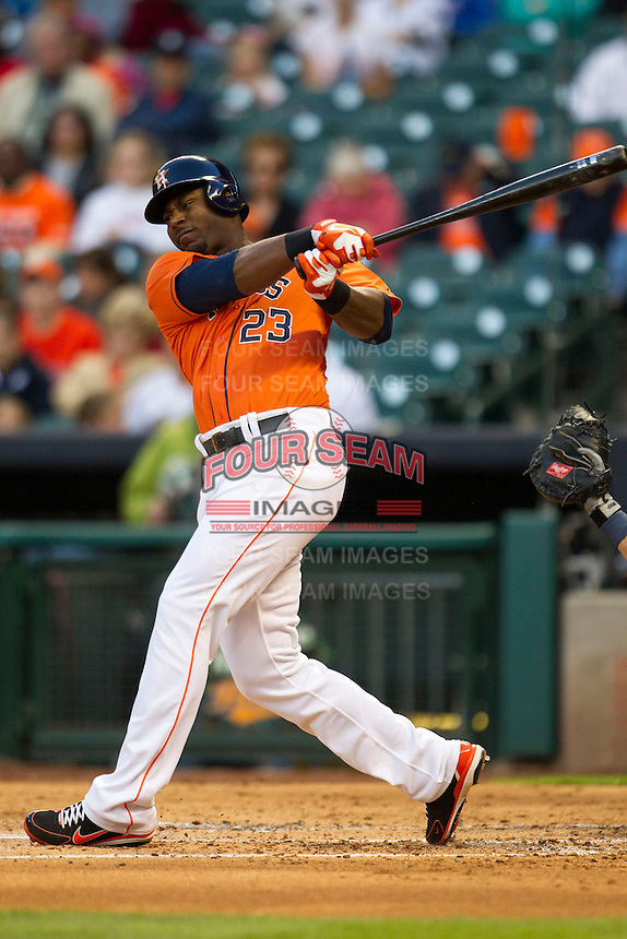Houston Astros outfielder Chris Carter (23) follows through on his swing during the MLB baseball game against the Detroit Tigers on May 3, 2013 at Minute Maid Park in Houston, Texas. Detroit defeated Houston 4-3. (Andrew Woolley/Four Seam Images).
