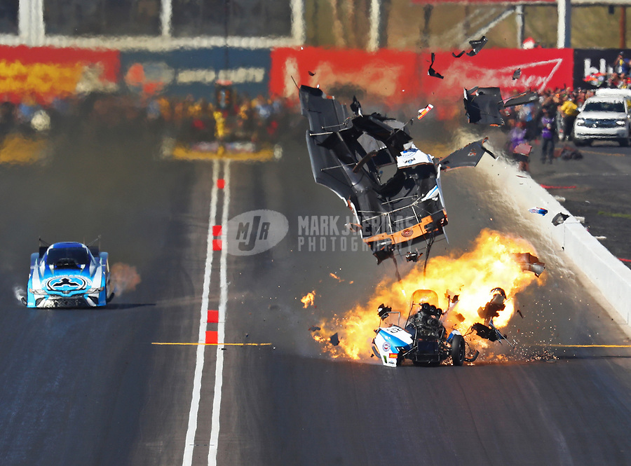 Feb 25, 2018; Chandler, AZ, USA; NHRA funny car driver John Force explodes the body off his car on fire alongside Jonnie Lindberg during the Arizona Nationals at Wild Horse Pass Motorsports Park. Mandatory Credit: Mark J. Rebilas-USA TODAY Sports