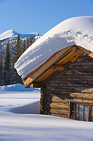 Snow load on a log cabin roof in Wiseman, Alaska