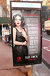 Lindsay Lohan appears in an Ad for the Lifetime Movie LIZ & DICK at a telephone booth in New York City. 12/28/2011