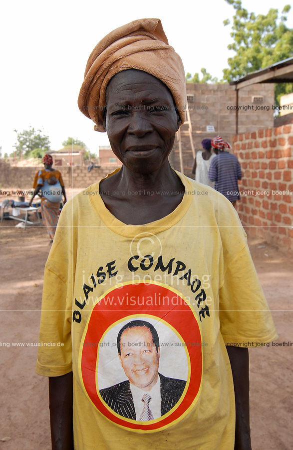 BURKINA FASO , woman in T-shirt with image of former president Blaise Comaore