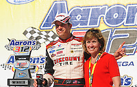 Apr 25, 2009; Talladega, AL, USA; NASCAR Nationwide Series driver David Ragan celebrates with his mother Beverly Ragan after winning the Aarons 312 at the Talladega Superspeedway. Mandatory Credit: Mark J. Rebilas-