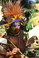 Oceania,Papua New Guinea, hull man preparing for Sing Sing dance