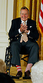 "Former United States President George H.W. Bush and U.S. President Barack Obama (not pictured) at a ceremony in the East Room of the White House to present the 5,000th ""Daily Point of Life"" on July 15, 2013.  Photograph by Dennis Brack<br /> Credit: Dennis Brack / Pool via CNP"