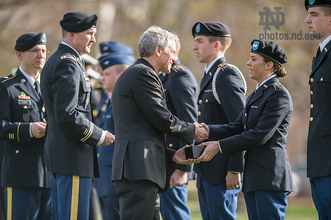 Apr. 15, 2015; Notre Dame President Rev. John Jenkins, C.S.C. congratulates ROTC cadets and midshipmen honored during the annual Pass-in-Review ceremonies. (Photo by Matt Cashore/University of Notre Dame)