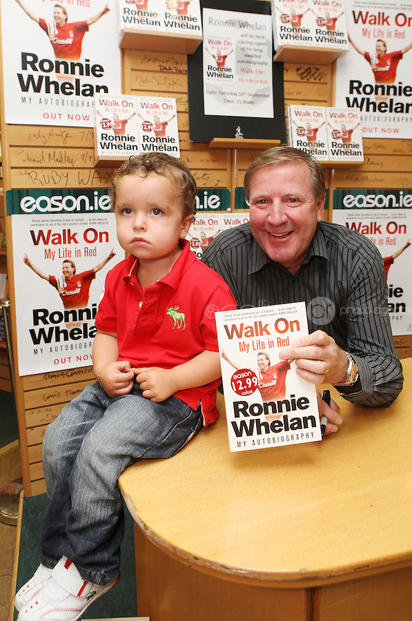 ***NO FEE PIC ***.10/09/2011.Eason Ireland's leading retailer of books , stationery, magazines & lots more hosted a book signing by former Liverpool & Irish international soccer player Ronnie Whelan..Pictured at Eason O' Connell street, Dublin is Ronnie Whelan &  Blake Robinson Hogan (3) from Tyrellstown signing copies of his new autobiography WALK ON for fans..Follow Eason on twitter- @easons..Photo: Collins