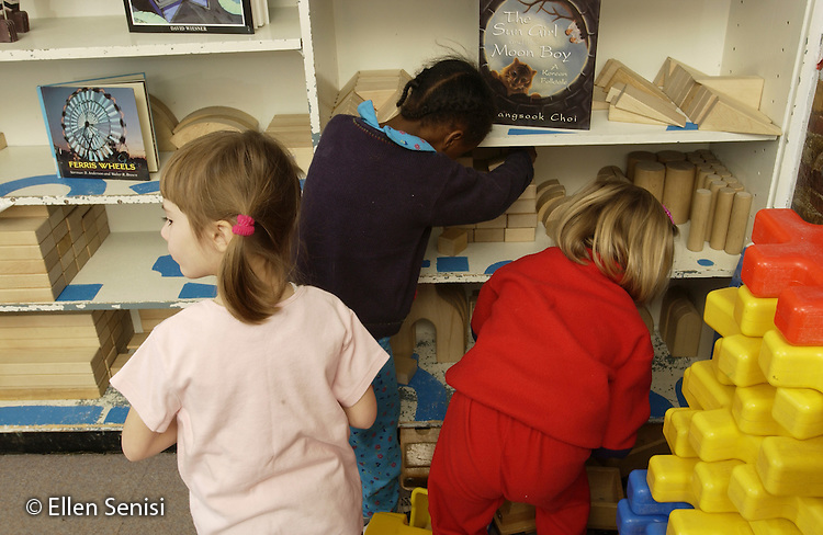 MR / Schenectady, NY                                  .Yates Arts-in-Education Magnet School (urban school).Pre-Kindergarten classroom; NYS Universal Pre-K Program.Girls (4, 5) clean up blocks after free play time..MR:  She14   Smi14   Bea1.©Ellen B. Senisi