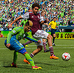 Seattle Sounders' DeAndre Yedlin kicks the ball away from Colorado Rapids' Christopher Klute during an MLS match on April 26, 2014 in Seattle, Washington.  The Seattle Sounders beat the Colorado Rapids 4-1.  Jim Bryant Photo. ©2014. All Rights Reserved.