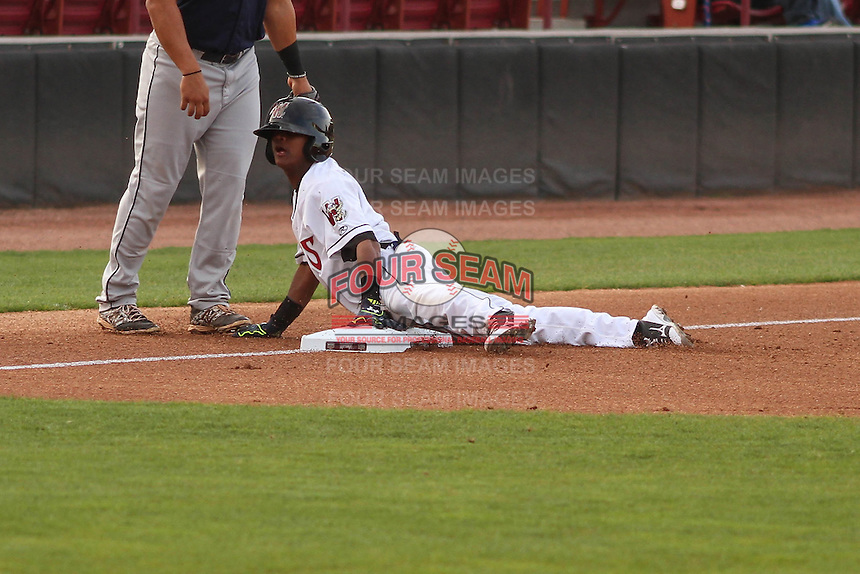 Wisconsin Timber Rattlers second baseman Gregory Munoz (7) slides into third base during a game against the Cedar Rapids Kernels on May 4th, 2015 at Fox Cities Stadium in Appleton, Wisconsin.  Cedar Rapids defeated Wisconsin 9-3.  (Brad Krause/Four Seam Images)