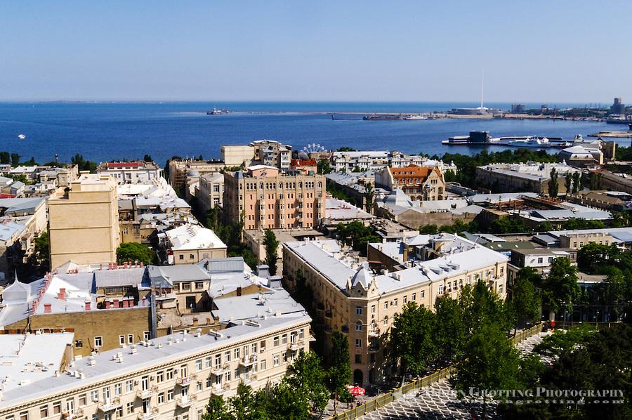 Azerbaijan, Baku. Baku city view with tha harbour and the Caspian Sea in the background.