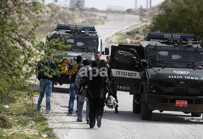 Israeli troops remove the ,Piet AXA, checkpoint  near Ramot settlement, northern Jerusalem, March 12, 2012.. Photo by Issam Rimawi