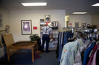 A man looks at items for sale at a Salvation Army thrift store in Pendleton, Oregon, USA.