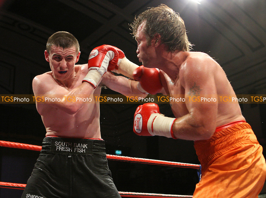 Pete McDonagh (Bermondsey, black shorts) defeated Duncan Cottier (Chingford, orange shorts) on a points decision - Light-Middleweight boxing at York Hall, Bethnal Green promoted by Hennessy Sports - 05/10/07 - MANDATORY CREDIT: Gavin Ellis/TGSPHOTO. Self-Billing applies where appropriate. NO UNPAID USE. Tel: 0845 094 6026
