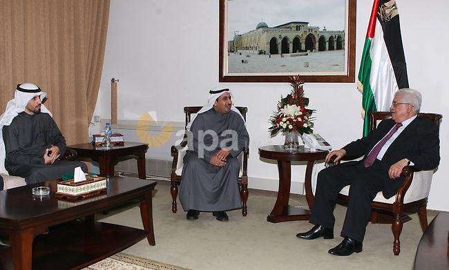Palestinian President Mahmoud Abbas, meet with with the researcher Talal Zaid Al-Marzouq, in the West Bank city of Ramallah, on March 06, 2012.  Photo by Thaer Ganaim