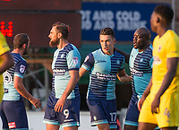Adebayo Akinfenwa congratulates Luke O'Nien of Wycombe Wanderers on his goal during the Friendly match between Wycombe Wanderers and AFC Wimbledon at Adams Park, High Wycombe, England on 25 July 2017. Photo by Andy Rowland.
