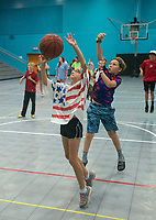 NWA Democrat-Gazette/BEN GOFF @NWABENGOFF<br /> Sadie Hayes (left), 9, of Rogers and Avery Tallmage, 10, both of Cave Springs, compete in a game of 'knock out' Friday, July 6, 2018, during the Rogers Activity Center summer day camp.