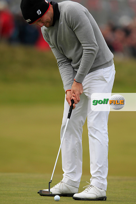 Maximilian KIEFFER (GER) takes his putt on the 18th green during Saturday's Round 3 of the 2015 Dubai Duty Free Irish Open, Royal County Down Golf Club, Newcastle Co Down, Northern Ireland 5/30/2015<br /> Picture Eoin Clarke, www.golffile.ie