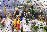 From left Seattle Sounders FC players Osvaldo Alonso, Fredy Montero and Alvaro Fernandez celebrate winning their third consecutive U.S. Open Cup during play between the Seattle Sounders FC and the Chicago Fire in the U.S. Open Cup Final at CenturyLink Field in Seattle Tuesday October 4, 2011. Seattle won the game 2-0.
