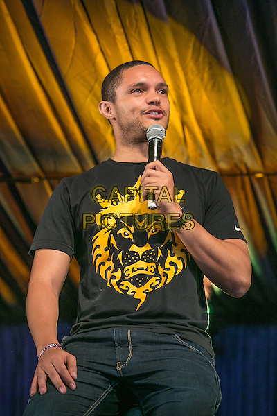 18th July 2014: South African Comedian Trevor Noah, the first South African comedian to appear on David Letterman&rsquo;s Late Show, plays the Comedy Arena on the second day of the 9th edition of the Latitude Festival, Henham Park, Suffolk.<br /> CAP/PP/HOG<br /> &copy; HOG/PP/Capital Pictures