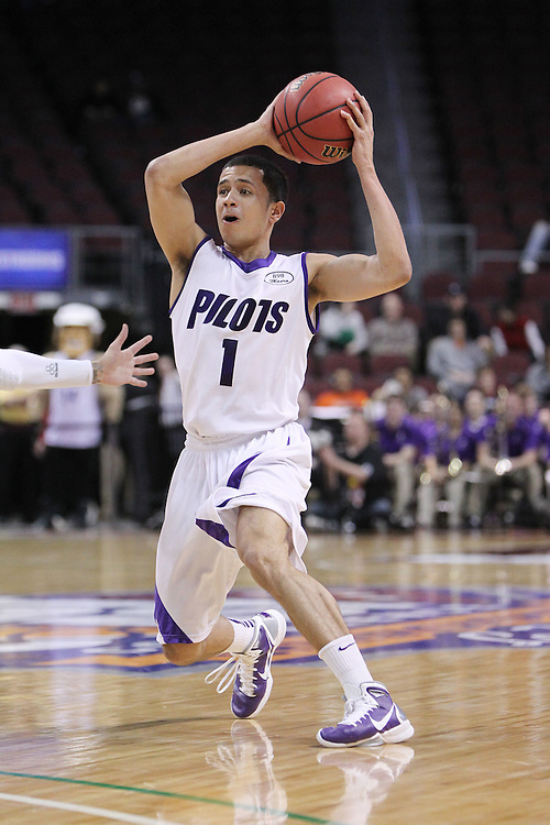 March 4, 2011; Las Vegas, NV, USA; Portland Pilots guard Eric Waterford (1) controls the ball against the Loyola Marymount Lions during the WCC Basketball Championships first round game at Orleans Arena. The Lions defeated the Pilots 72-68.