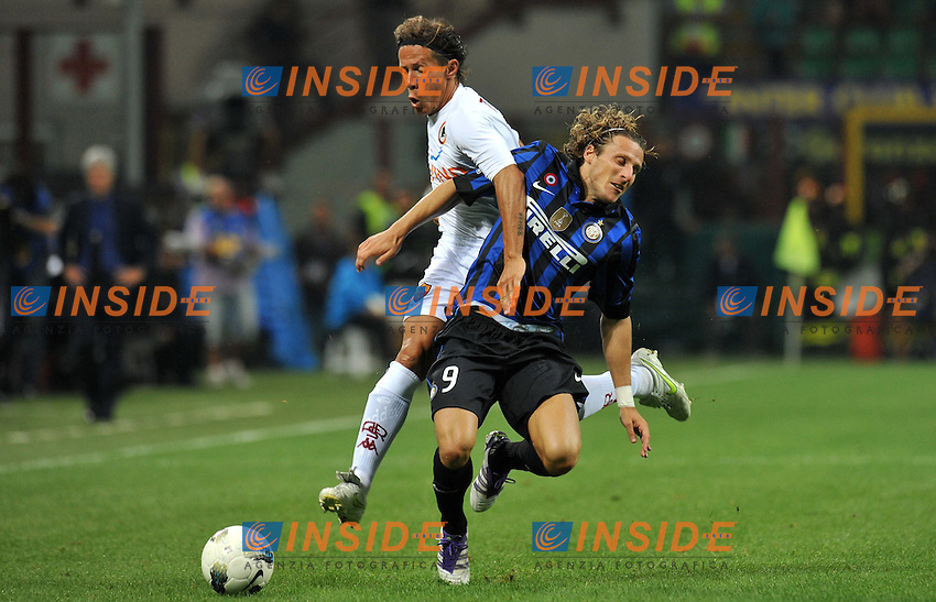 "Diego FORLAN (Inter), TADDEI (Roma).Milano 17/9/2011 Stadio ""Giuseppe Meazza"".Serie A 2011/2012 .Football Calcio Inter Vs Roma.Foto Insidefoto Alessandro Sabattini."