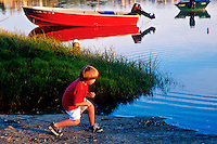 Boy skips rocks at the harbor, Orleans, Cape Cod