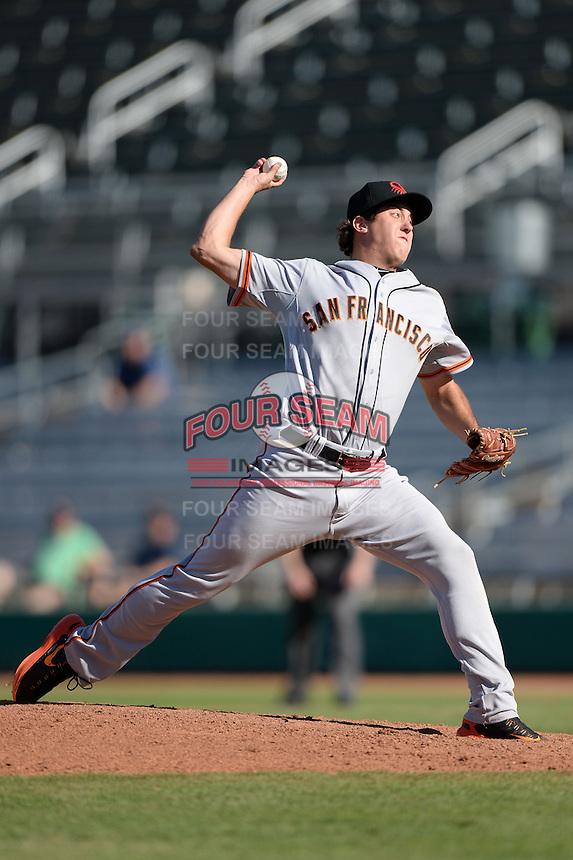 Scottsdale Scorpions pitcher Derek Law (64), of the San Francisco Giants organization, during an Arizona Fall League game against the Mesa Solar Sox on October 15, 2013 at HoHoKam Park in Mesa, Arizona.  Mesa defeated Scottsdale 7-4.  (Mike Janes/Four Seam Images)