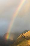 Rainbow among the mountains of Maui, Hawaii.