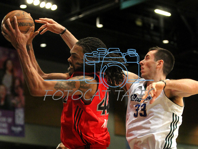 Reno Bighorns Christopher Ayer and Idaho Stampede's Mikki Moore fight for a rebound during a basketball game Sunday, April 1, 2012 in Reno, Nev. Idaho won 108-99..Photo by Cathleen Allison