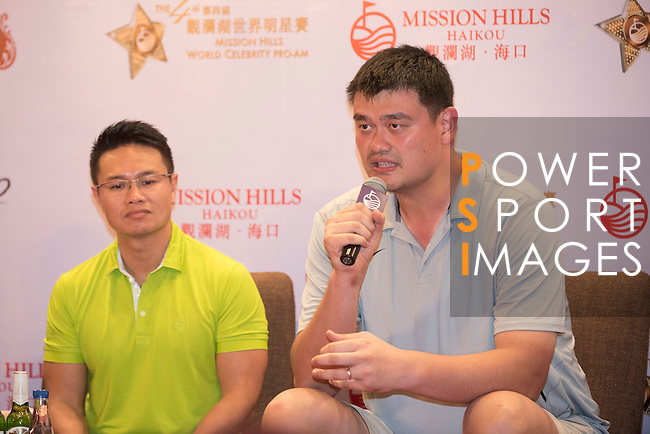 (L-R) Ken Chu, Yao Ming, during Sports Legends Press Conference on the sidelines of the World Celebrity Pro-Am 2016 Mission Hills China Golf Tournament on 22 October 2016, in Haikou, China. Photo by Weixiang Lim / Power Sport Images