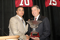 14 January 2007: Bob Bowlsby presents an award to Trevor Hooper at the annual football banquet at McCaw Hall in Stanford, CA.