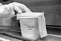 Usa. Utah. Tooele county. Deseret chemical depot. A worker wears a plastic glove on his left hand. Plastic bucket containing hazardous waste. GB lab liquid waste. Decontamination tag. The item cannot leave government control. Tooele chemical agent disposal facility (TOCDF). Program for destruction of chemical weapons and agent. Incinerating plant. Deseret chemical depot is distant 100 km from Salt Lake City. The Deseret Chemical Depot is one of eight Army installations in the U.S. that currently store chemical weapons. The weapons originally stored at the depot consisted of various munitions and ton containers, containing GB and VX nerve agents or H, HD, and HT blister agent. The Tooele Chemical Agent Disposal Facility is designed for the sole purpose of destroying the chemical weapons stockpile located at the depot. © 1998 Didier Ruef