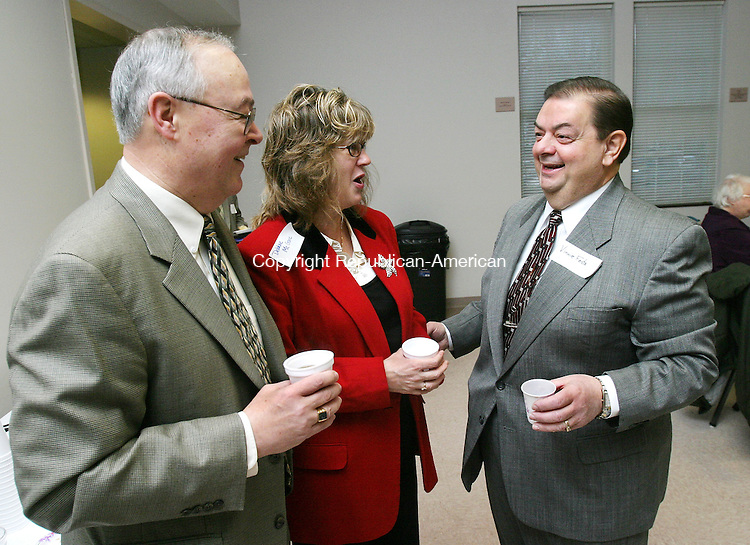 PLYMOUTH, CT. 09 January 2008-010908SV01-- From left, John Leone of the Greater Bristol Chamber of Commerce, Debbie McGrane of the Terryville Lions Club, and Mayor Vincent Festa talk during a breakfast in Terryville Wednesday. The Mayor Festa invited clergy, civic organizations, town officials, and private businesses to a communal breakfast to help bring the town together and share ideas of how to better the town. Festa was elected in November.<br /> Steven Valenti Republican-American