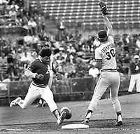Athletics Tim Hosley tries to beat out hit against the Tigers Jason Thompson. (1977 photo/Ron Riesterer)