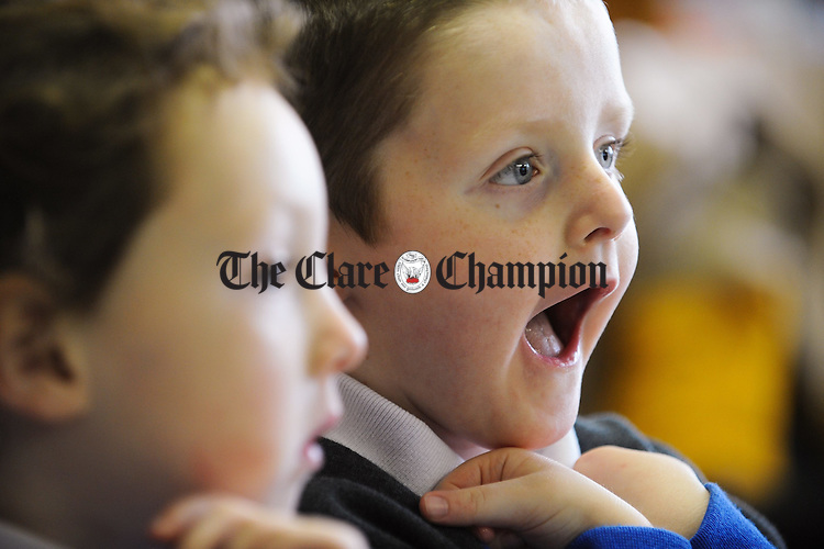 Joshua Markham listens to a scary story with friend Amber O Sullivan, at St Senan's NS, Shannon. Photograph  by John Kelly.