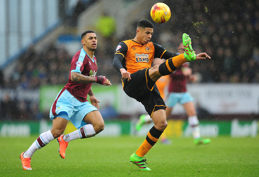Hull City's Curtis Davies clears the ball under pressure from Burnley&rsquo;s Andre Gray<br /> <br /> Photographer Chris Vaughan/CameraSport<br /> <br /> Football - The Football League Sky Bet Championship - Burnley v Hull City - Saturday 6th February 2016 - Turf Moor - Burnley <br /> <br /> &copy; CameraSport - 43 Linden Ave. Countesthorpe. Leicester. England. LE8 5PG - Tel: +44 (0) 116 277 4147 - admin@camerasport.com - www.camerasport.com